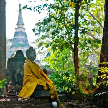 Statue of Buddha in the ancient temple in Chiangmai, Thailand