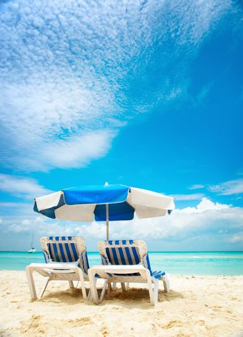Vacation and Tourism concept. Sunbeds on the beach