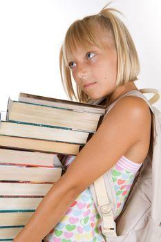 Back To School. Little Schoolgirl With Heavy Books