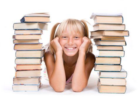Back To School Concept. School Girl Between The Stacks Of Books