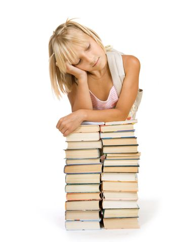 Back To School Concept. School Girl Above The Heap Of Books