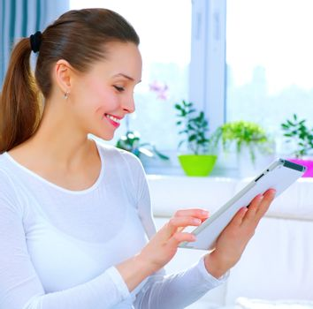 Young Woman With Touchpad At Home.Computer.