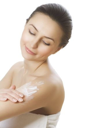 Young Woman Applying Moisturizer. Skincare Concept
