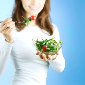 Dieting Concept. Happy Young Woman Eating Vegetable Salad