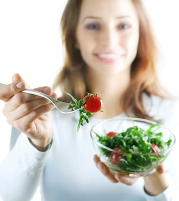 Healthy Eating Concept. Happy Young Woman Eating Vegetable Salad