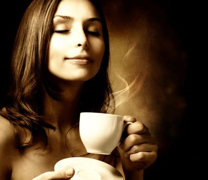 Beautiful Woman With Coffee. Isolated on black. Copy-space
