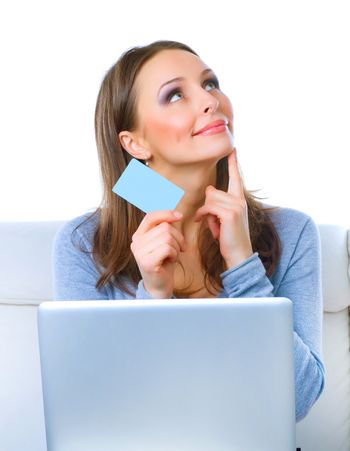 Happy Woman shopping on-line with credit card and computer.Inter