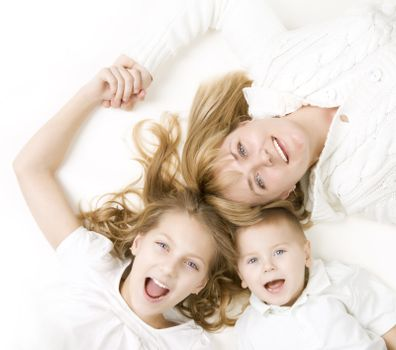 Happy family. Mother with kids over white