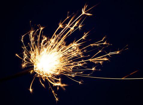 close up burning christmas sparkler