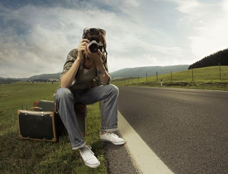 A woman photographer on the side of the road.Copy space
