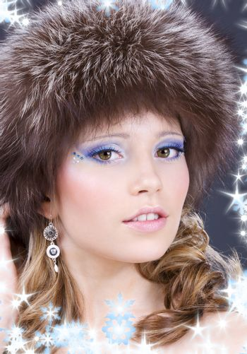 lovely woman in furry hat over grey