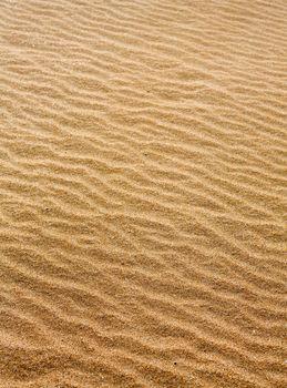 Beach sand waves warm texture pattern