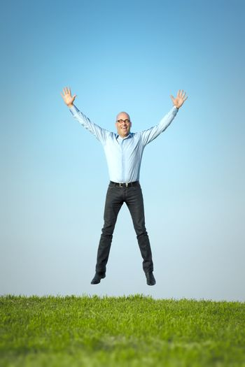 An image of a happy jumping man
