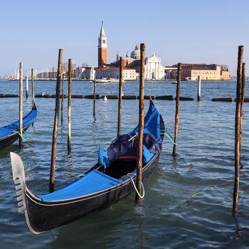 Famous view of San Giorgio maggiore with gondolas
