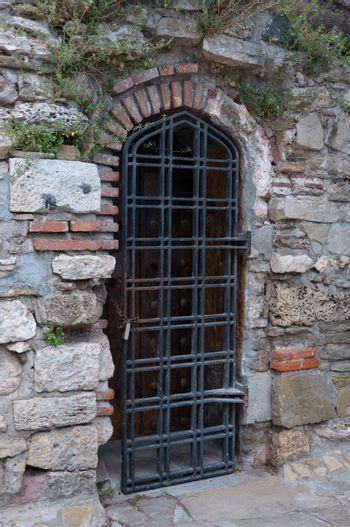 Door grille in an old brick wall.