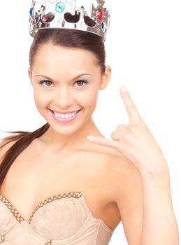 woman in crown showing devil horns gesture