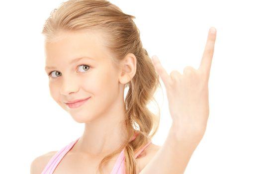 happy girl showing devil horns gesture