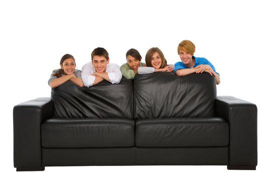teenagers behind sofa
