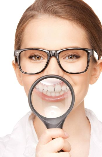 picture of woman with magnifying glass showing teeth