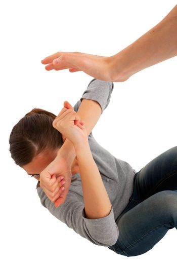 teenage girl protect herself with arms crossed in front of face