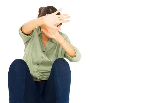 teenage girl protect herself with arms in front of face