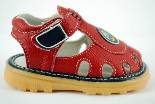 Children red sandal on white