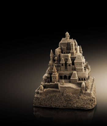 large sandcastle with many towers and crenels in retro look