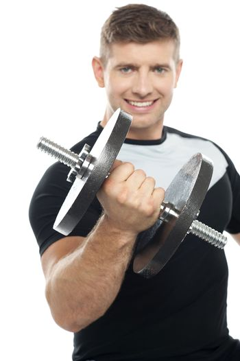 Gym instructor posing with heavy dumbbell