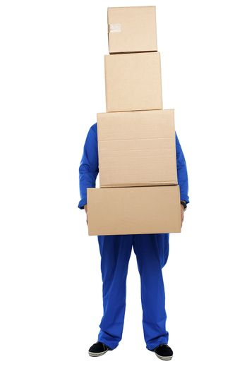 Guy overloaded with pile of cartons