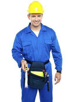 Repairman at work holding measuring tape