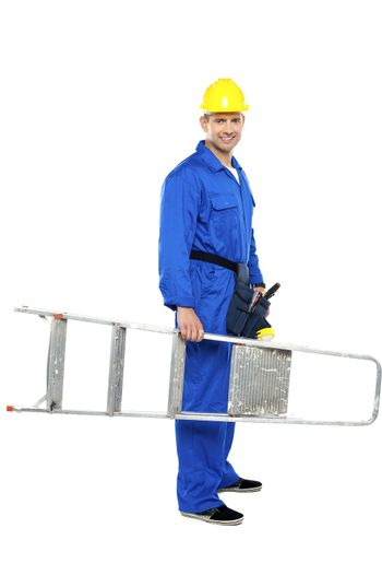Young repairman ready with stepladder