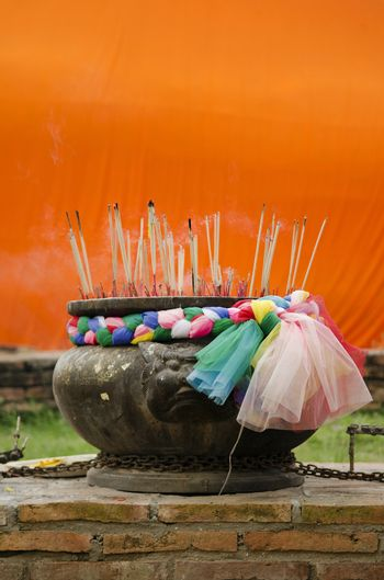 incense at buddhist temple in thailand