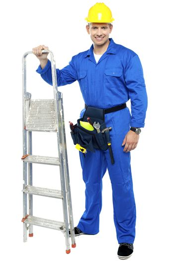 Worker ready to get to work with stepladder