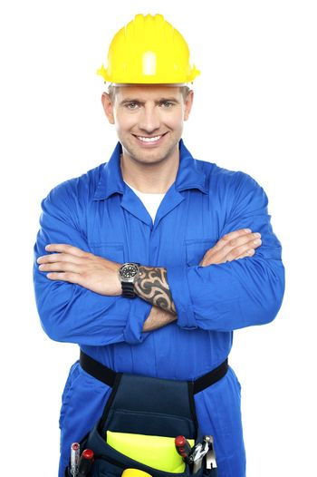 Young repairman in uniform posing with crossed arms