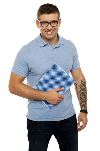 Modern college student holding notebook