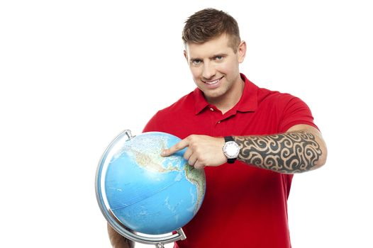 Cool guy holding and pointing at the globe