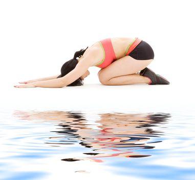 woman practicing ashtanga yoga posture