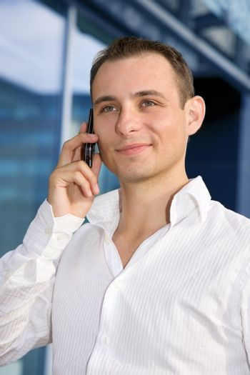 picture of handsome businessman with cell phone