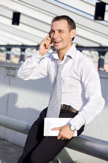 picture of businessman with cell phone and laptop