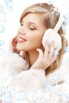 smiling blond in furry headphones
