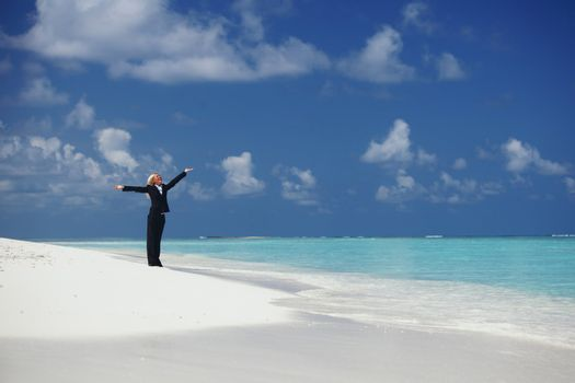 happy business woman on the ocean coast