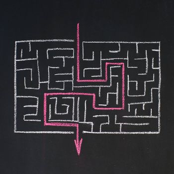 Way to the exit in labyrinth, drawn on a blackboard