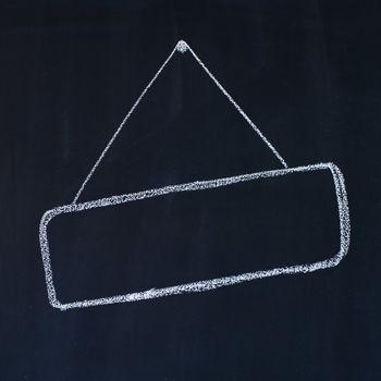 Blank frame on a blackboard, chalk drawing