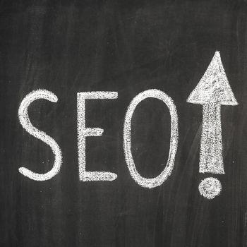 Abbreviation 'SEO' written on the blackboard