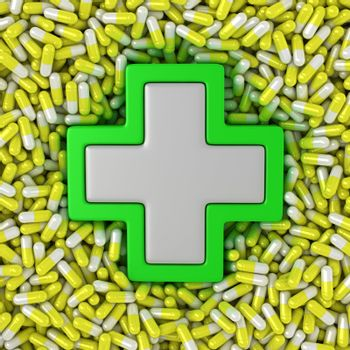 Medical cross sign on the yellow pills background