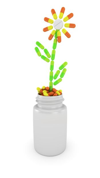 Flower made from capsules is growing in medical bottle