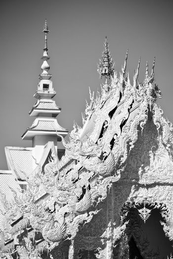 Beautiful white temple Wat Rong Khun.  Wat Rong Khun is a contemporary unconventional Buddhist temple in Chiang Rai, Chiangmai province, Thailand. It is designed in white color.