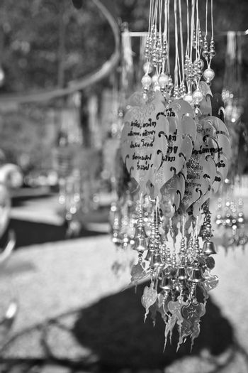 Traditional buddhist hanging decorations with bells and handwriting wishes, prayer words