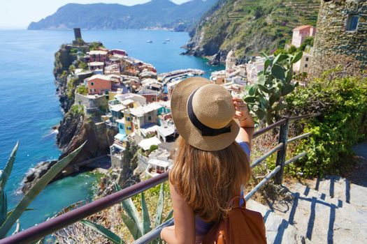 Female backpacker enjoying view of spectacular landscape of Vernazza from the Azure Trail, Cinque Terre, Italy