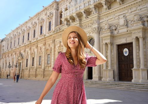 Young travel girl strolling among the cultural and baroque beauties of Lecce, Apulia, Italy